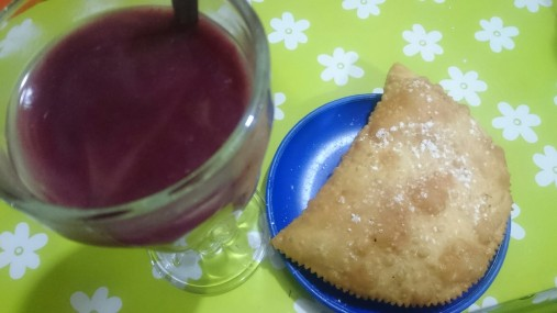 API - a hot purple corn drink served with pastel, a fluffy thin pastry filled with cheese
